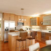 Фото Оформление стильной кухни в пламенном модном цвете FLAME со столешницей из искусственного белого камня (кварцита)